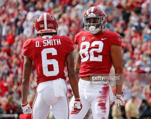 Irv Smith Jr #82 of the Alabama Crimson Tide reacts after scoring a touchdown against the Citadel Bulldogs with DeVonta Smith at BryantDenny Stadium...
