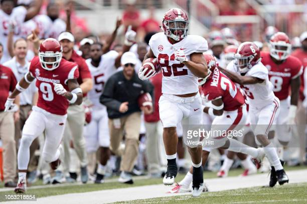 Irv Smith Jr #82 of the Alabama Crimson Tide runs the ball for a touchdown in the first quarter of a game against the Arkansas Razorbacks at...