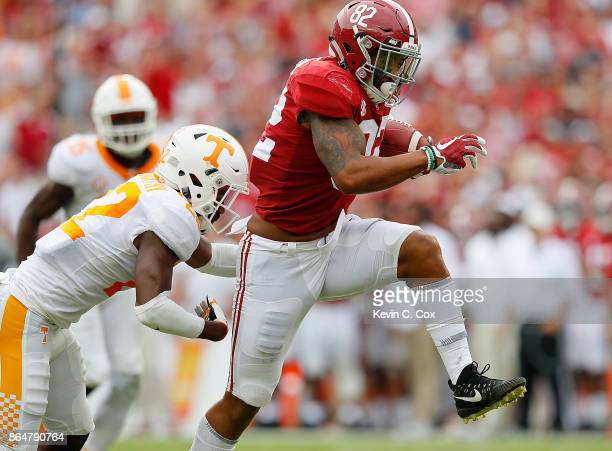 Irv Smith Jr #82 of the Alabama Crimson Tide rushes away from Micah Abernathy of the Tennessee Volunteers at BryantDenny Stadium on October 21 2017...