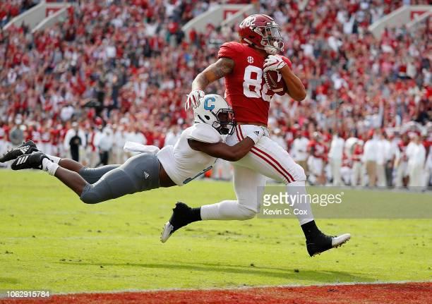 Irv Smith Jr #82 of the Alabama Crimson Tide scores a touchdown against Joshua Bowers of the Citadel Bulldogs at BryantDenny Stadium on November 17...
