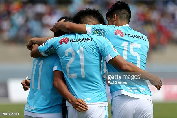 Irven Avila of Sporting Cristal celebrates with his teammates after scoring the second goal of his team against Cesar Vallejo during a second leg...