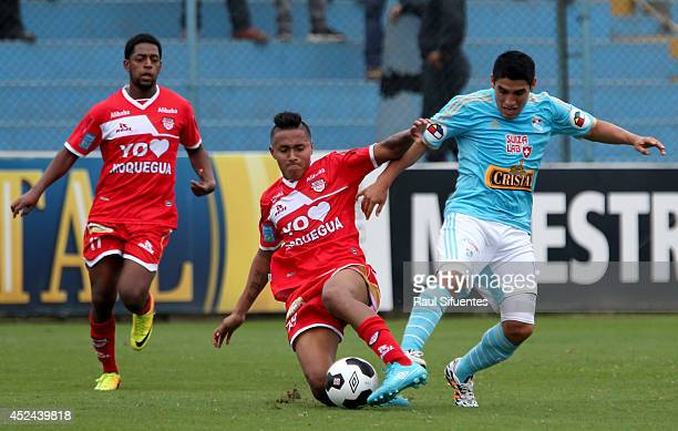 Irven Avila of Sporting Cristal struggles for the ball with Gustavo Stagnaro of San Simon during a match between Sporting Cristal and San Simon as...
