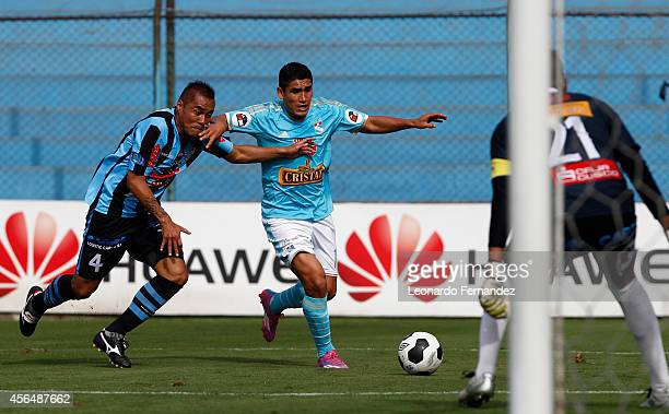 Irven Avila of Sporting Cristal struggles for the ball with Manuel Ugaz of Real Garcilaso of during a match between Sporting Cristal and Real...