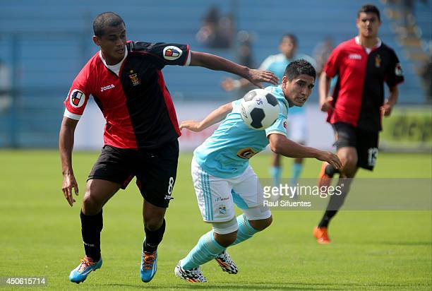 Irven Avila of Sporting Cristal struggles for the ball with Nelinho Quina of FBC Melgar during a match between Sporting Cristal and FBC Melgar as...