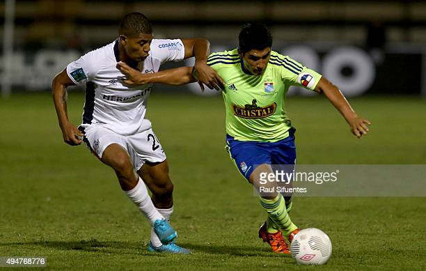 Irven Avila of Sporting Cristal struggles for the ball with Wilder Cartagena of San Martin during a match between San Martin and Sporting Cristal as...