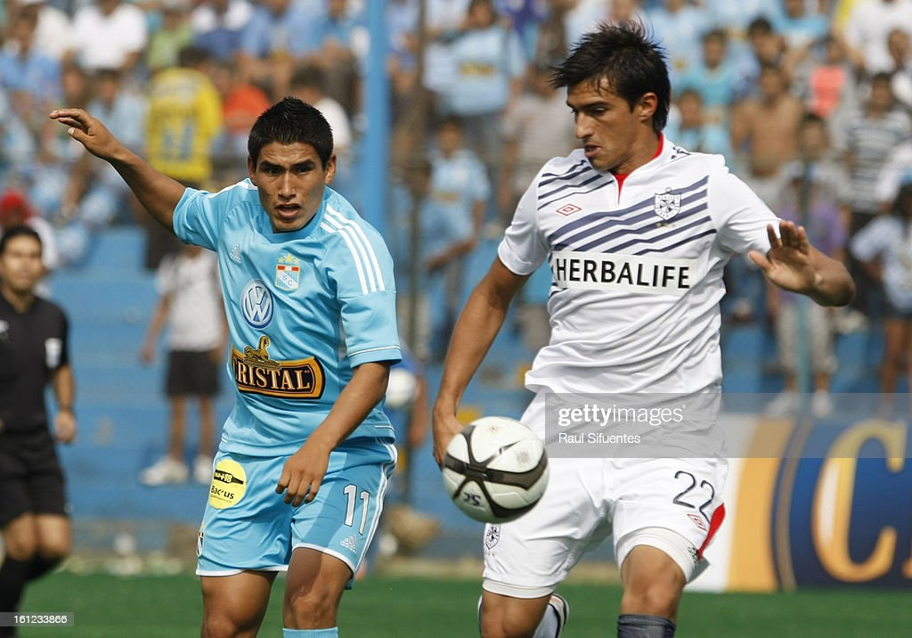 Irvin Avila of Sporting Cristal fights for the ball with Esteban Maga of San Martin during a match between Sporting Cristal and San Martin as part of The 2013 Torneo Descentralizado at the Alberto Gallardo Stadium on February 09, 2013 in Lima, Peru