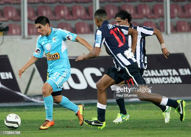 Irvin Avila of Sporting Cristal fights for the ball with Wilder Cartagena of Alianza Lima during a match between Sporting Cristal and Alianza Lima as...