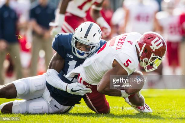Irvin Charles of the Penn State Nittany Lions strips the ball from J-Shun Harris II of the Indiana Hoosiers during a punt return, Penn State...