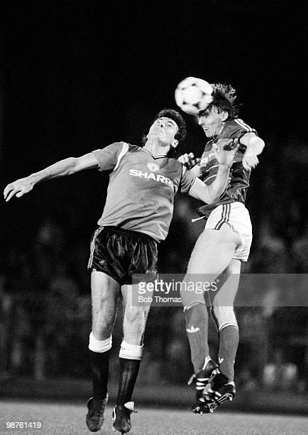 Irvin Gernon of Ipswich Town outjumps Frank Stapleton of Manchester United during the Division One football match held at Portman Road Ipswich on...