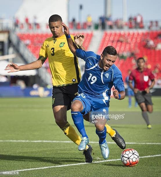 Irvin Herrera of El Salvador battles Michael Hector of Jamaica during the first half of their CONCACAF Gold Cup match in Toronto Canada on July 14...