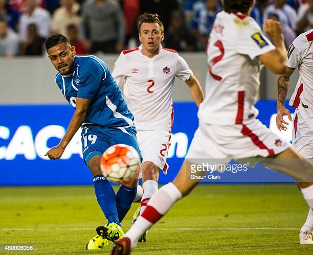 Irvin Herrera of El Salvador takes a shot on goal past Dejan Jakovic of Canada during the 2015 CONCACAF Gold Cup Group B match between El Salvador...