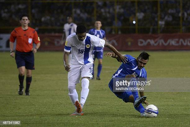 Irvin Herrera of the National football Team of El Salvador fights for the ball against Michael Maria of the National selection of Curazao at the...