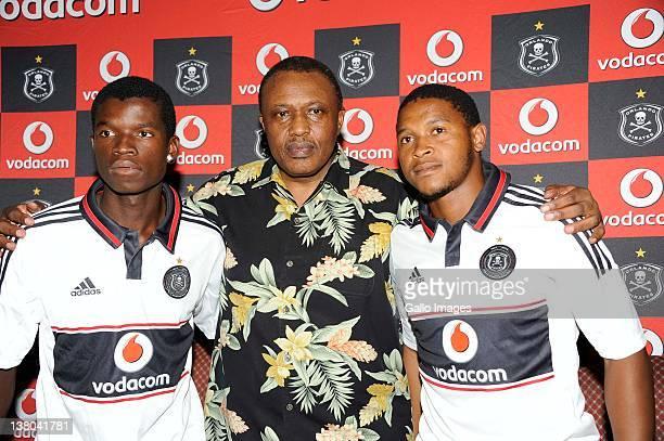 Irvin Khoza Chairman of Orlando Pirates with new signings Sifiso Myeni and Thandani Ntshumayelo during the Orlando Pirates press conference at the...