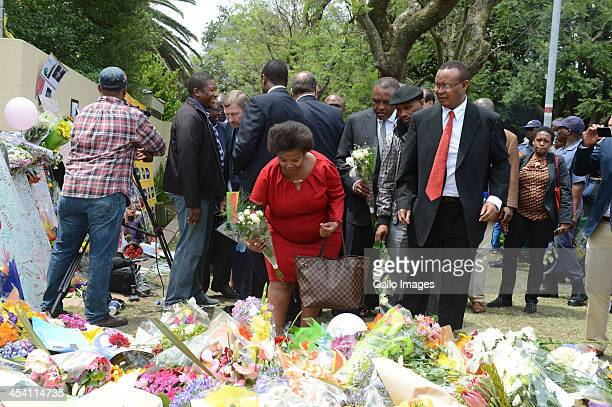 Irvin Khoza lays flowers amongst the thousands of tributes to Former President Nelson on December 7 2013 in Johannesburg South Africa The Father of...