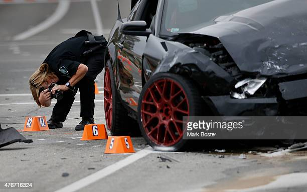 Irvine Police Department CSI Debra Werksman documents the the scene of a fatal hitandrun accident at the intersection of Muirlands Blvd and Alton...