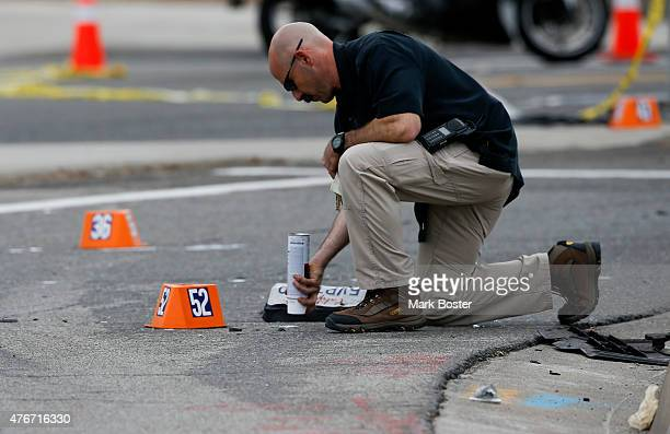 Irvine Police Department Investigator Jonathan Cherney looks for evidence at the the scene of a fatal hitandrun accident at the intersection of...