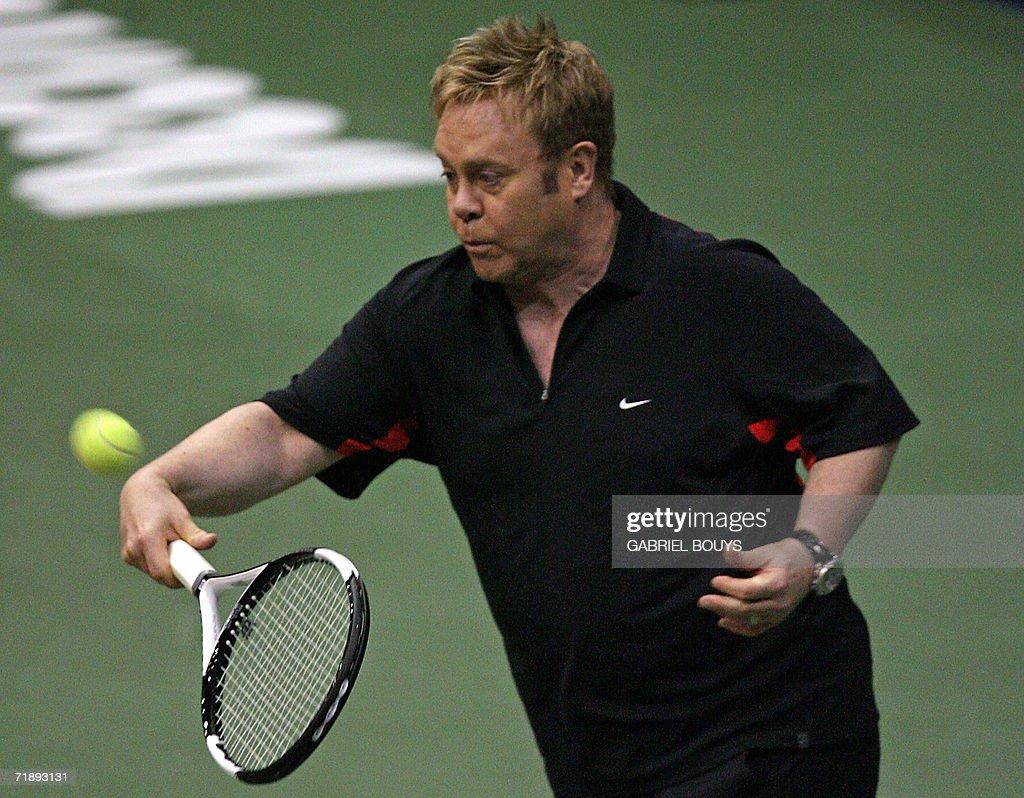 British Singer Sir Elton John Plays Tennis In A Celebrity Double