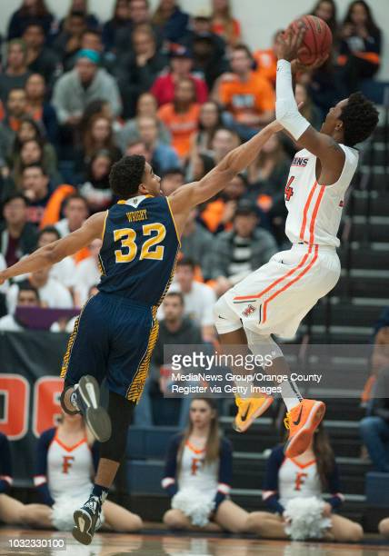 Irvine's Aaron Wright tries to stop Cal State Fullerton's Khalil Ahmad during the Anteaters' 9677 victory Wednesday in Fullerton ucicsfbk0218kjs...