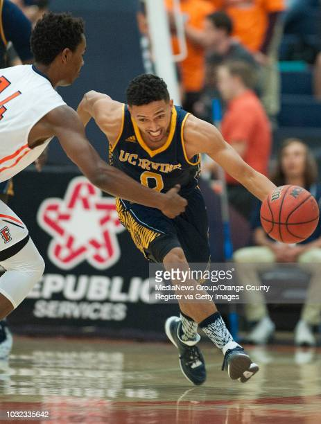 Irvine's Jaron Martin drives past Cal State Fullerton's Khalil Ahmad during the Anteaters' 9677 victory Wednesday in Fullerton ucicsfbk0218kjs Photo...