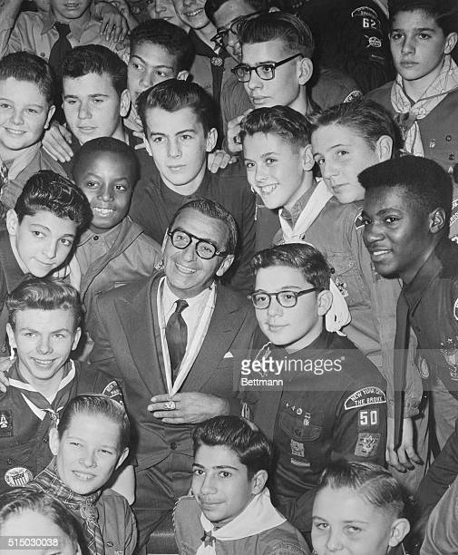 Irving Berlin is seen here surrounded by Boy Scouts after he had received the Silver Beaver Award He was thus honored for creating the God Bless...