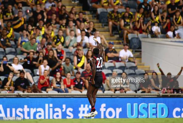 Irving Mosquito of the Bombers celebrates after kicking his first goal on debut during the round 13 AFL match between the Essendon Bombers and the...