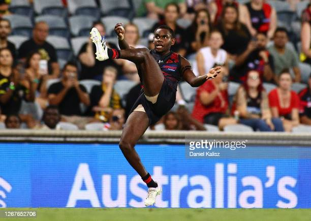 Irving Mosquito of the Bombers kicks his first goal on debut during the round 13 AFL match between the Essendon Bombers and the Richmond Tigers at...