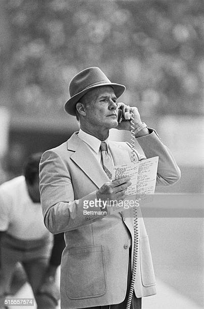 Irving, Texas: Cowboys coach Tom Landry looks over his selection of plays during 3rd quarter action against the Rams.
