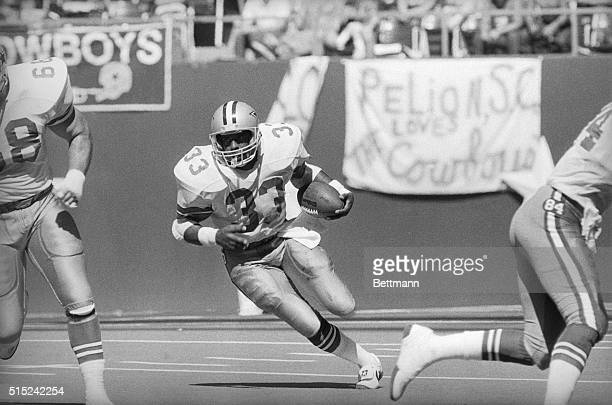 Irving, Texas: Dallas Cowboy Tony Dorsett breaks inside for 19 yards to gain more than 10,000 yards in his career.