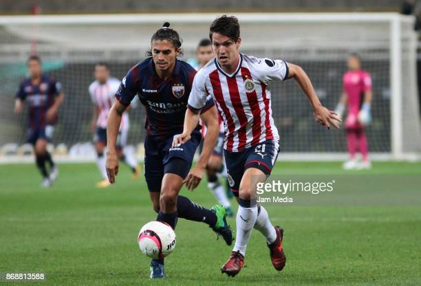 Irving Zurita of Atlante fights for the ball with Carlos Fierro of Chivas during the quarter final match between Chivas and Atlante as part of the...