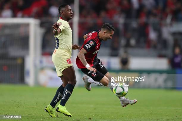 Irving Zurita of Atlas fights for the ball with Alex Ibarra Mina of America during the 2nd round match between Atlas and America as part of the...