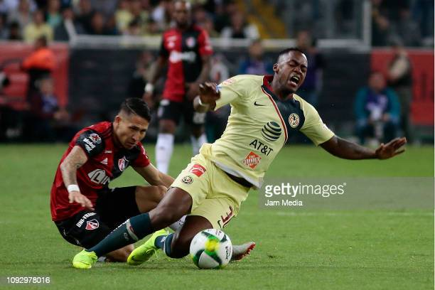 Irving Zurita of Atlas fights for the ball with Renato Ibarra of America during the 2nd round match between Atlas and America as part of the Torneo...