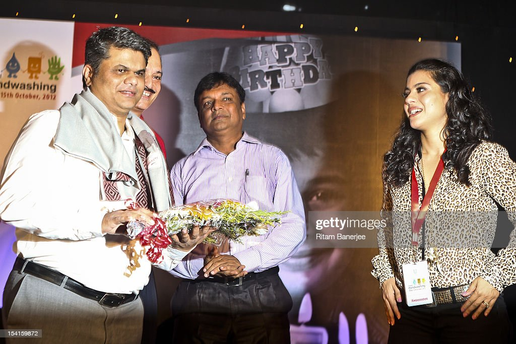 Irwin Fernandes of Save the Children stands alongside CEO MD of Unilever India Nitin Paranjpe the School Principal and Bollywood actress Kajol attend.