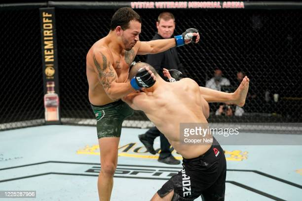 Irwin Rivera of Mexico kicks Giga Chikadze of Georgia in their featherweight fight during the UFC Fight Night event at VyStar Veterans Memorial Arena...
