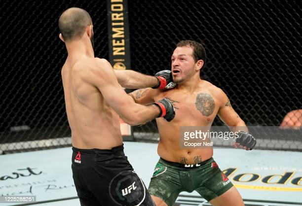 Irwin Rivera of Mexico punches Giga Chikadze of Georgia in their featherweight fight during the UFC Fight Night event at VyStar Veterans Memorial...