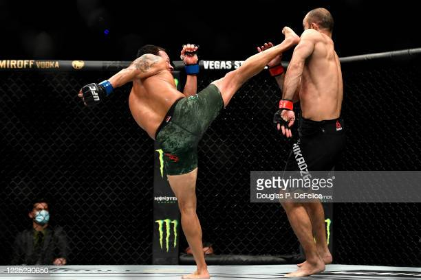 Irwin Rivera of the United States kicks Giga Chikadze of Georgia in their Featherweight bout during UFC Fight Night at VyStar Veterans Memorial Arena...