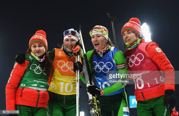 Iryna Kryuko Dzinara Alimbekava Darya Domracheva and Nadezhda Skardino of Belarus celebrate winning gold after the Women's 4x6km Relay on day 13 of...