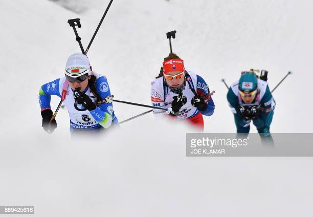 Iryna Kryuko of Belarus Ivona Fialkova of Slovakia and Yuliia Dzhima of Ukraine compete during the women's 4x6 km relay event at the IBU World Cup...