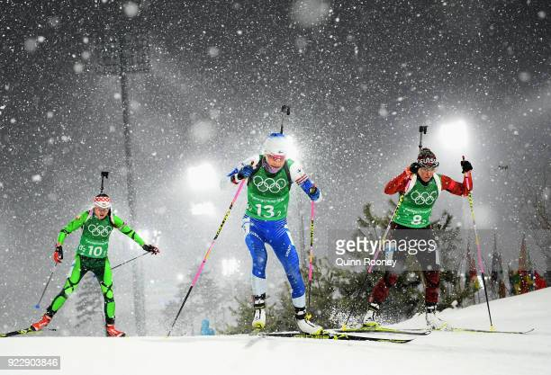 Iryna Kryuko of Belarus, Kaisa Makarainen of Finland and Elisa Gasparin of Switzerland compete during the Women's 4x6km Relay on day 13 of the...