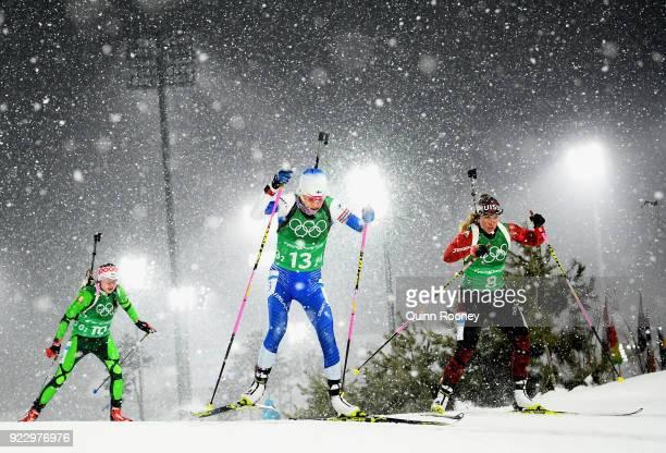Iryna Kryuko of Belarus Kaisa Makarainen of Finland and Lena Haecki of Switzerland compete during the Women's 4x6km Relay on day 13 of the...