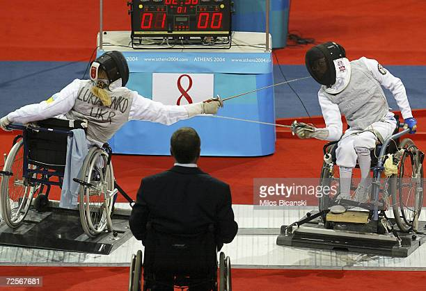 Iryna Lykyanenko of Ukraine and Yui Chong Chan of China duel during their Women's Individual Foil Wheelchair Fencing contest at the Athens 2004...