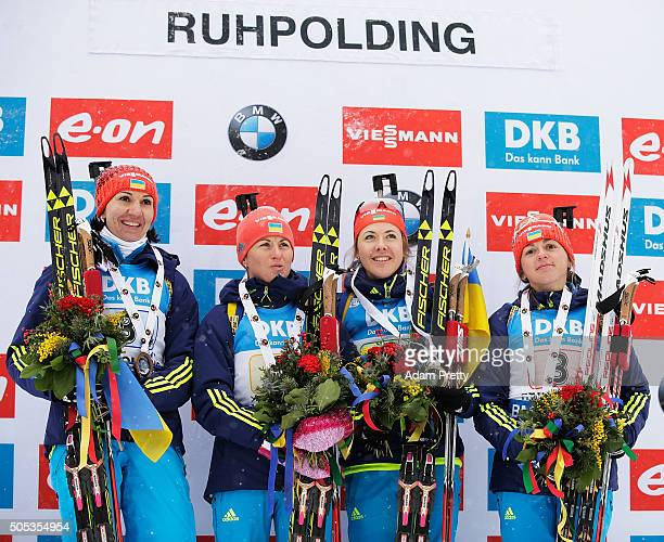 Iryna Varvynets Yulia Dzhima Valj Semerenko and Olena Pidhrushna of the Ukraine celebrate first place on the podium after the Women's 4x 6km relay on...