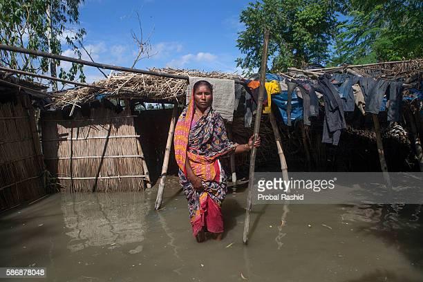 is a flood victim stands in the plunged yard of her home in Sarishabari Jamalpur According to the Bangladesh Disaster Management Bureau around 15...