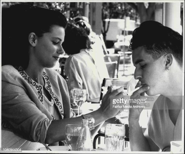 Is Chivalry Dying Saulwick PollNikki Brooks lights a cigarette for friend Tim Saunders September 12 1988