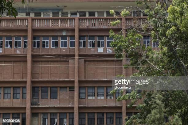 'SOS VZLA' is displayed on a window outside the Luis Razetti University Hospital in Barcelona Venezuela on Thursday Aug 24 2017 The ruling...