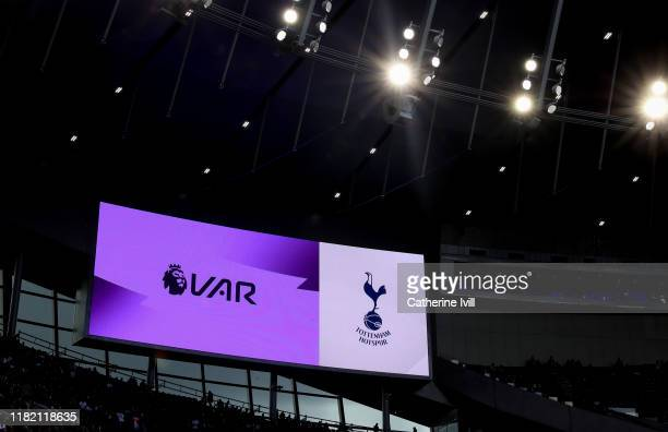 Is displayed on the screen next to the Tottenham Club badge ahead of the Premier League match between Tottenham Hotspur and Watford FC at Tottenham...