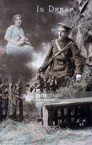 'Is Dream' 1915 A photomontage showing an American soldier standing at a fence and a young woman holding roses behind him Western Front World War I...