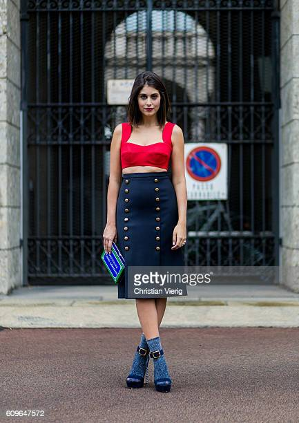 is Fashion and lifestyle blogger Nour Arida wearing a red Prada crop top a navy Michael Kors pencil skirt Poise Design platforms Calzedonia glittery...