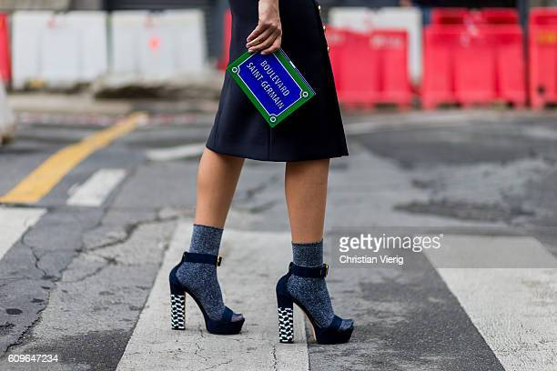 is Fashion and lifestyle blogger Nour Arida wearing Poise Design platforms Calzedonia glittery socks 'Yazbuky' clutch seen outside during Milan...