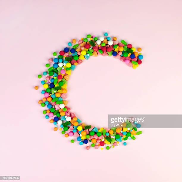 c is for candy - font stock photos and pictures