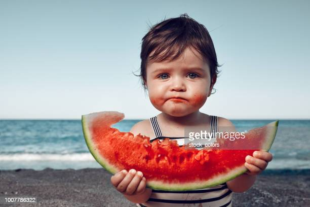 is it delicious?! - watermelon stock pictures, royalty-free photos & images